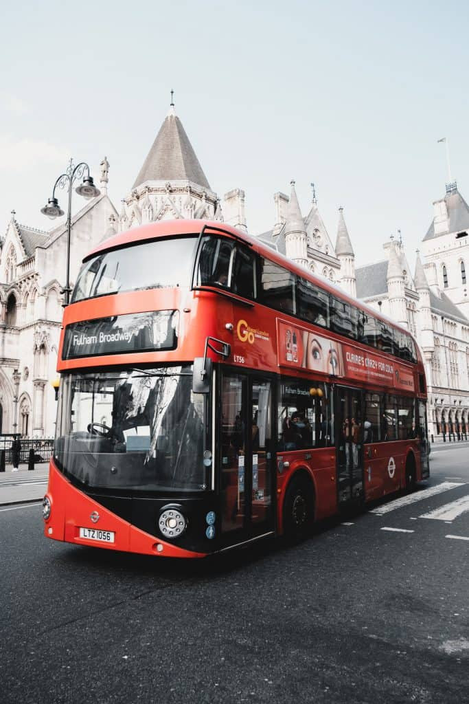 A red bus: public transportation helps reduce our carbon footprint and live more sustainably.